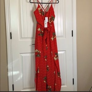 Red floral split leg jumpsuit.